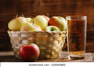 apple juice on wooden background. apple juice in glass. basket full of apple. autumn colors and leaves