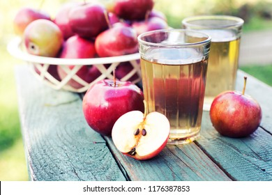 apple juice over summer nature background