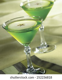 Apple Martini in glasses on green background