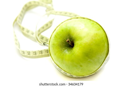 Apple and measure on white background