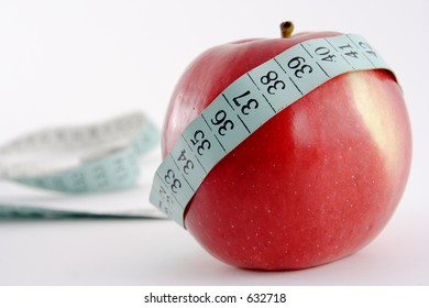 An apple and a measure tape