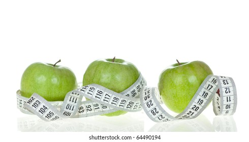 Apple and a measure tape - diet concept