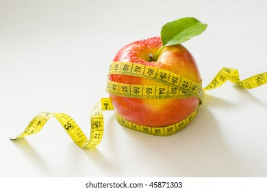 Apple with measure type isolated on gray