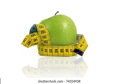 Apple with measuring tape isolated in white