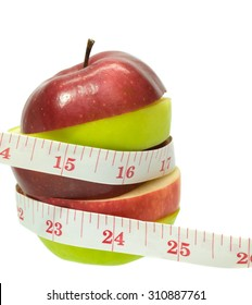 apple with measuring tape on white background