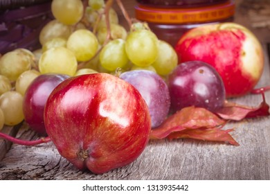 apple on a background of other fruits on a wooden background