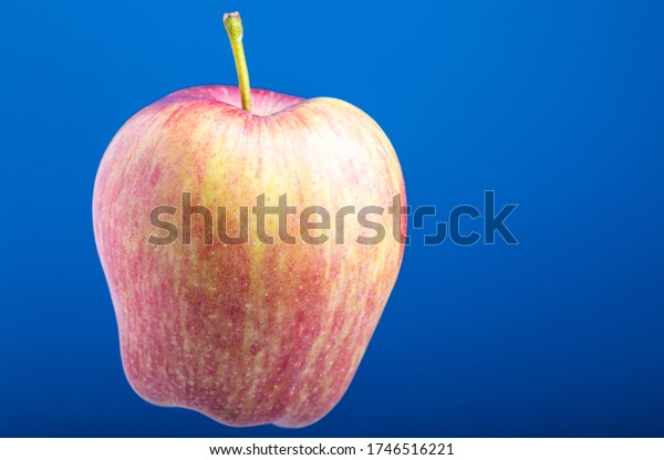 Apple on a blue background. Fruits on a blue background. Isolated from background. Vegetarian food. Fruit in a slimming diet.