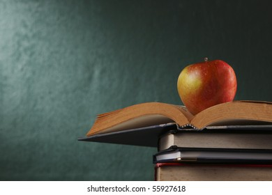 apple on stack of book