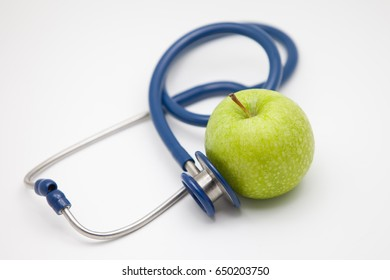 Apple on white background,stethoscope and apple.