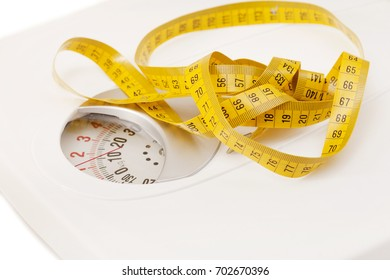 an apple on the white weight scale.