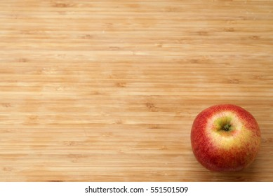 Apple on wood background