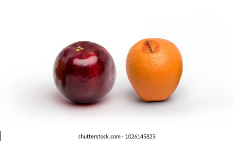 An apple and an orange having switched resemblance isolated on a white background