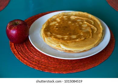 An apple and pancakes