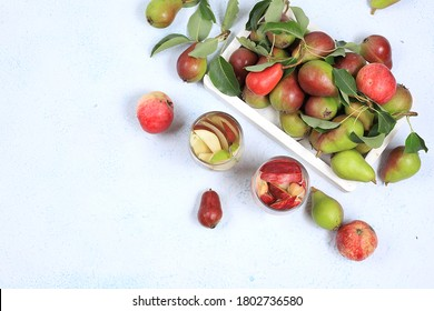 Apple and pear cider, juice or fruit drink and ingredients on a sunny table. The concept of diet and weight loss. Apples help cleanse the body and reduce weight. Healthy eating,