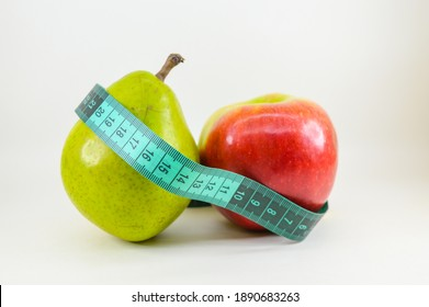 Apple and pear girded with a sewing meter