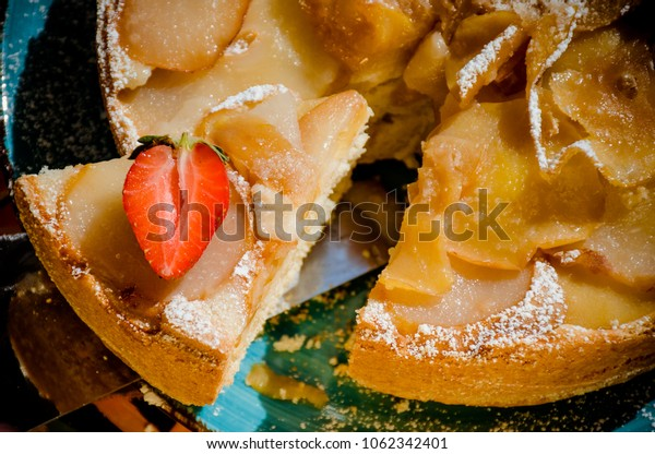 apple and pear pie on the blue plate