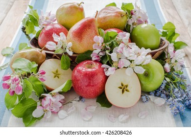 Apple and pears composition with spring flower