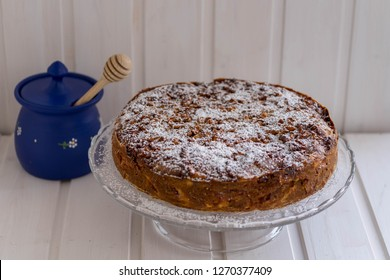 apple pie with candied walnuts and honeypot