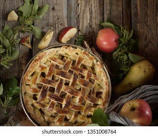 Apple pie in copper form. Apples and field flowers in old basket. Rustic style