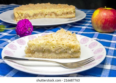 Apple pie with a flower on a blue table place mat
