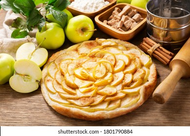 apple pie with fresh fruits on a wooden table