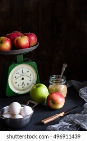 """Apple pie ingredients on rustic background.Title on scales: """"Only for home use"""""""