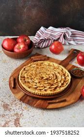 Apple pie on brown background