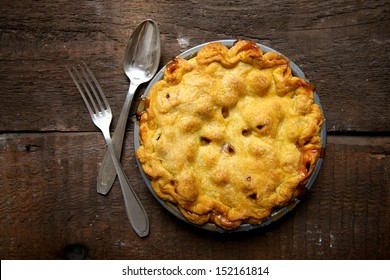 Apple Pie on a Brown Rustic Wooden Background with Spoon & Fork