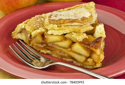 apple pie on a red plate