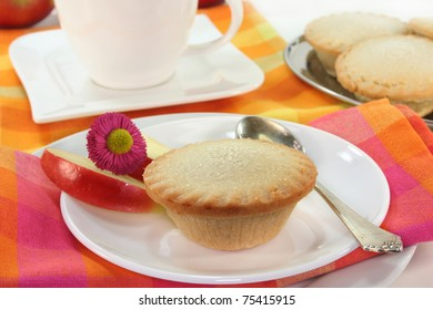 Apple pie on a small white plate