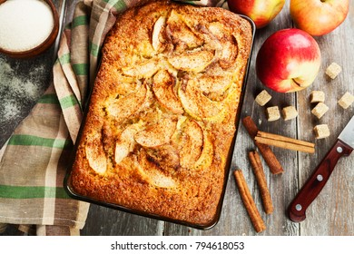 Apple pie with semolina and cinnamon on the table. Mannick