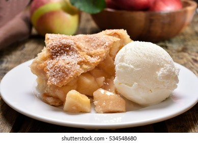 Apple pie served with ice cream.