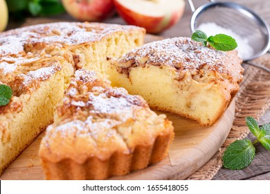 Apple pie, sponge cake, Charlotte with apples on a wooden table