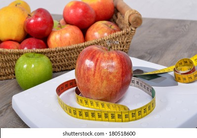 Apple placed on a scales and meter