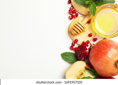 Apple, pomegranate and honey on white background. Home treatment