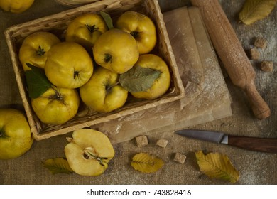 A lot of apple quince  with kitchenware,  preparing for quince pie on sackcloth rustic background.