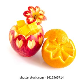 Apple red and Orange sunkist carved inside Mango cube style fruit for healthy high vitamin  decorate for party or fruit break side view isolated on white background