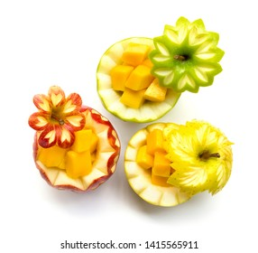 Apple red,green and Orange three type carved for fruit  break party inside with cube mango freshly fruit the good healthy side view isolated on white background