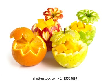 Apple red,green and yellow with Sunkist Orange carved for fruit break party inside with cube mango freshly fruit the good healthy side view isolated on white background
