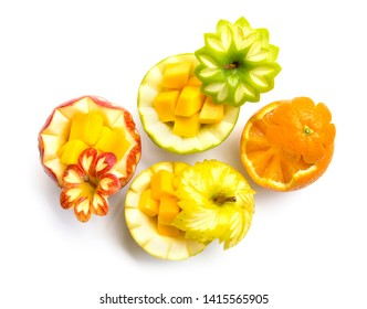 Apple red,green and yellow with Sunkist Orange carved for fruit break party inside with cube mango freshly fruit the good healthy top view isolated on white background