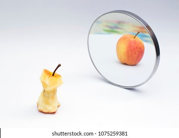 Apple reflecting in the mirror on white isolate background