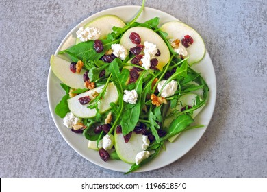 Apple salad with arugula, cottage cheese and dried cranberries. Salad for keto diet. Keto lunch idea.