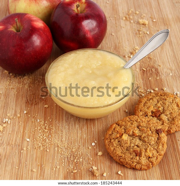 Apple sauce with oatmeal cookies and red apples