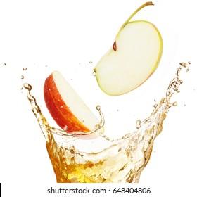 apple slices falling into splashing juice isolated on white