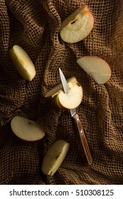subdued lighting. Apple Slices With Knife Above. Subdued Lighting. Lighting T
