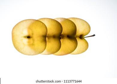 apple slices lit from the back