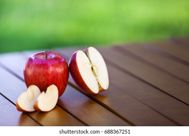 Apple and slices on table