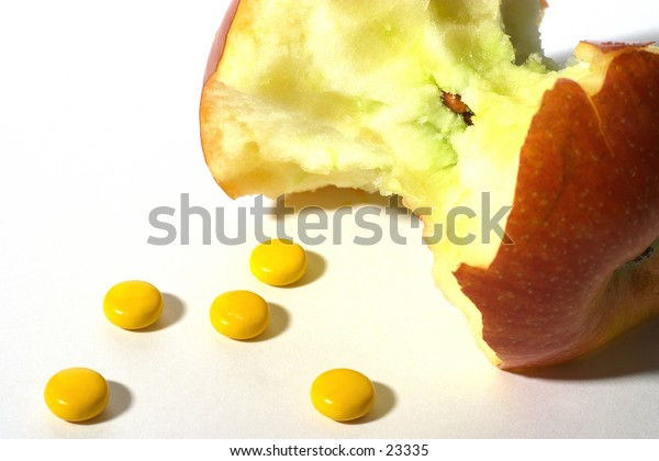 An apple with some vitamin pills - different routes to health.