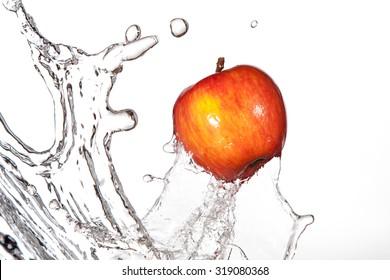 Apple splashing through water