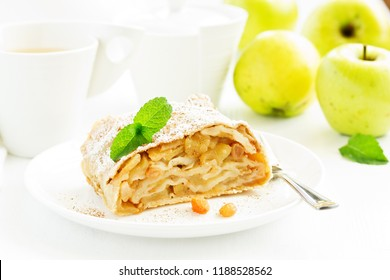 apple strudel with cinnamon and an ice cream ball.